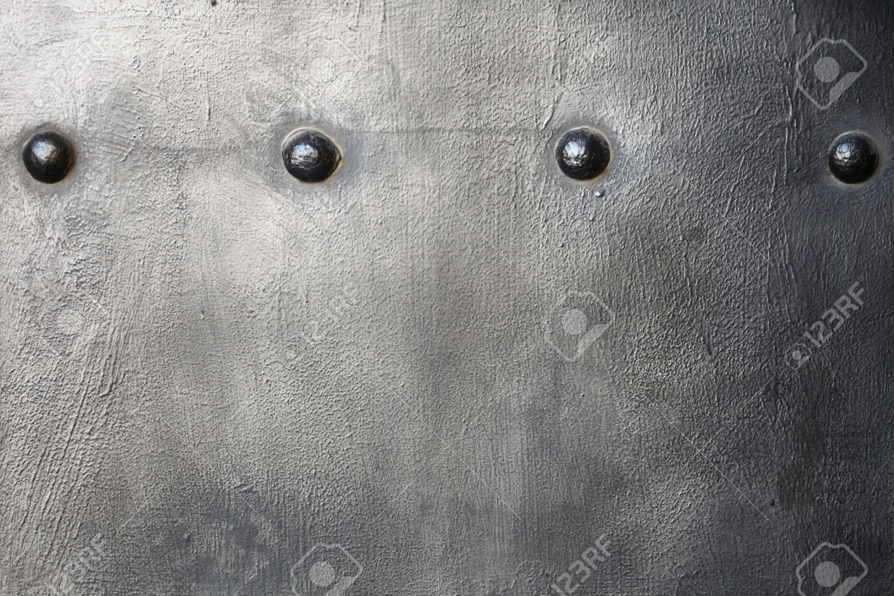 Black grunge metal plate or armour texture with rivets as background Stock Photo - 19219991