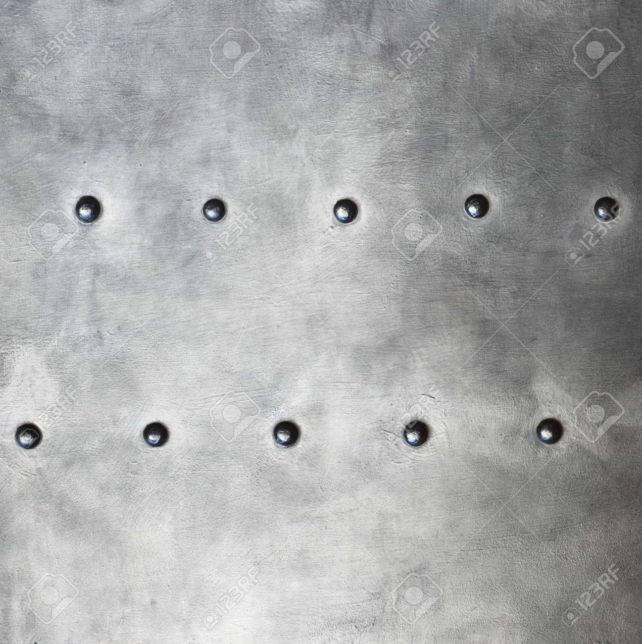 Black grunge metal plate or armour texture with rivets as background Stock Photo - 19282530