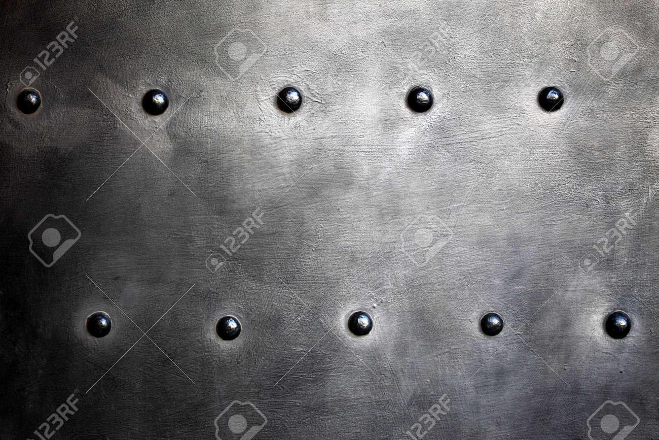 Black grunge metal plate or armour texture with rivets as background Stock Photo - 19970047