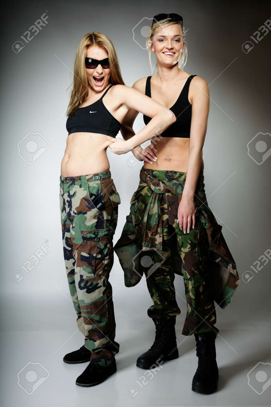 Full length two women in military clothes army girls on gray background.  Stock Photo - f0764b6b7d