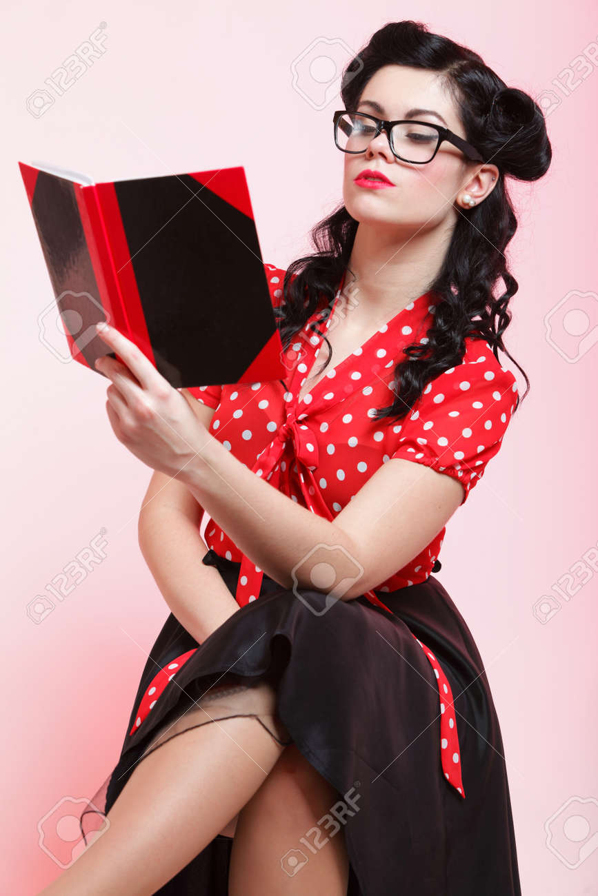 Portrait of a young woman, college student or teacher notebook in hand Stock Photo - 20327601