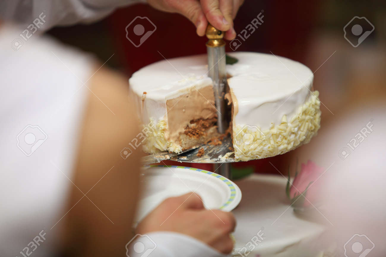 One Hand Cutting Beautiful Chocolate Wedding Cake With Knife Stock