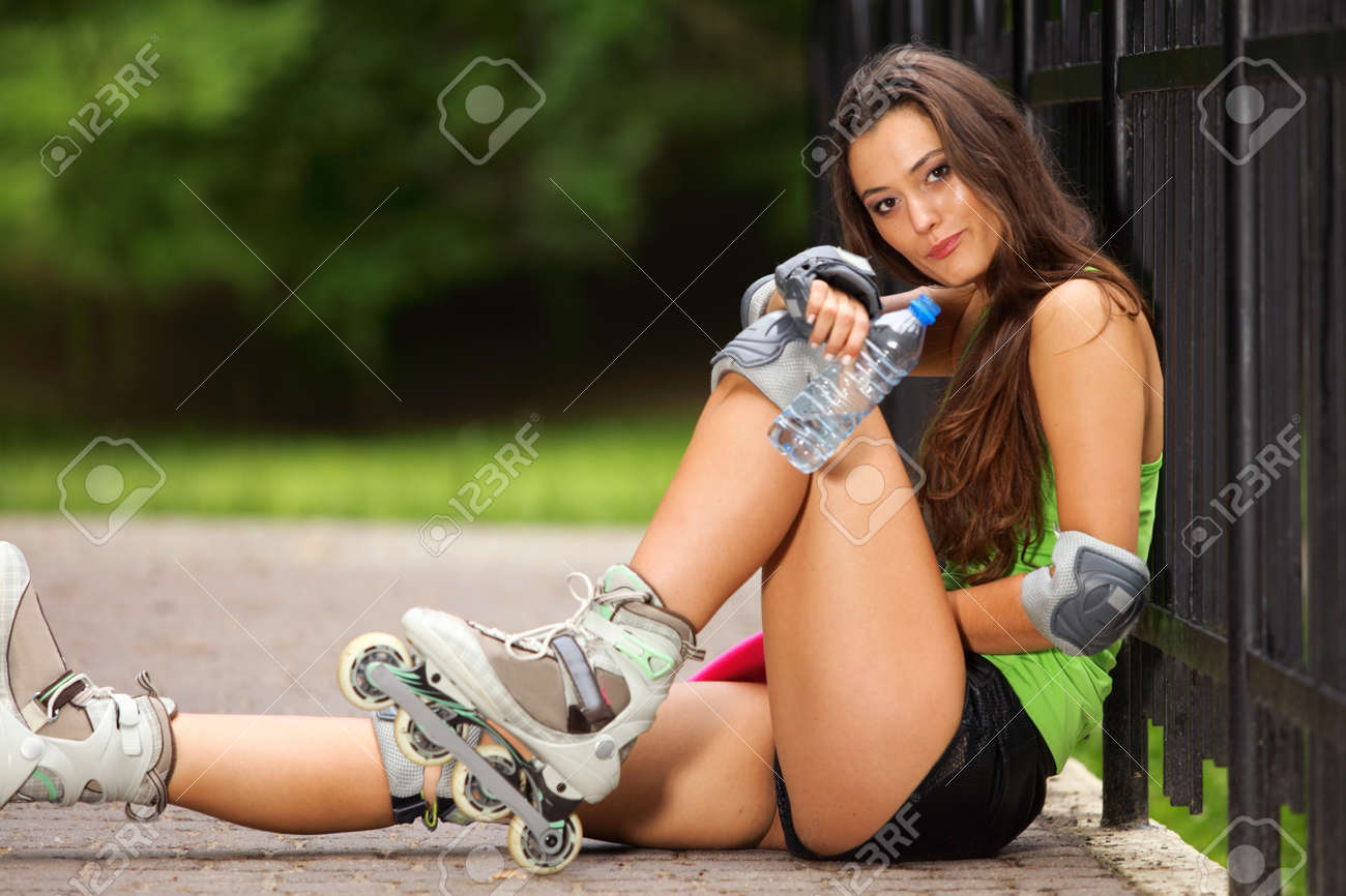 Happy young girl enjoying roller skating rollerblading on inline skates sport in park Stock Photo - 22073230