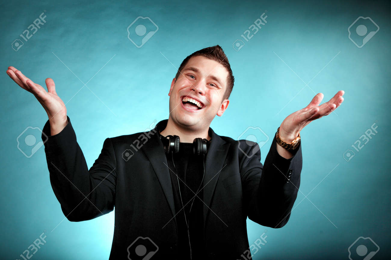 Young Happy Man Student Music Lover With Headphones Blue Background