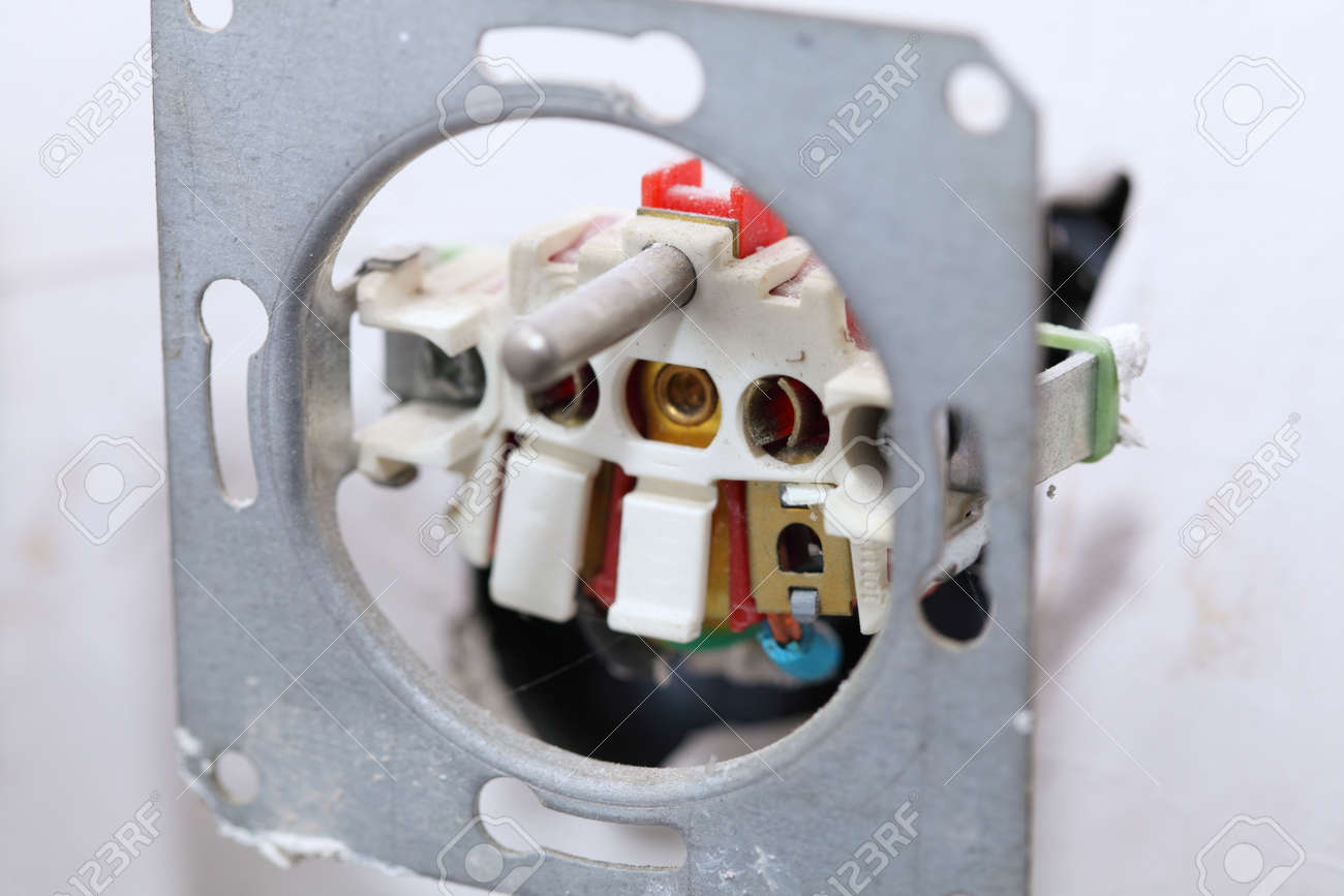 Close Up Installing A Power Socket. Opened Light Switch With.. Stock ...