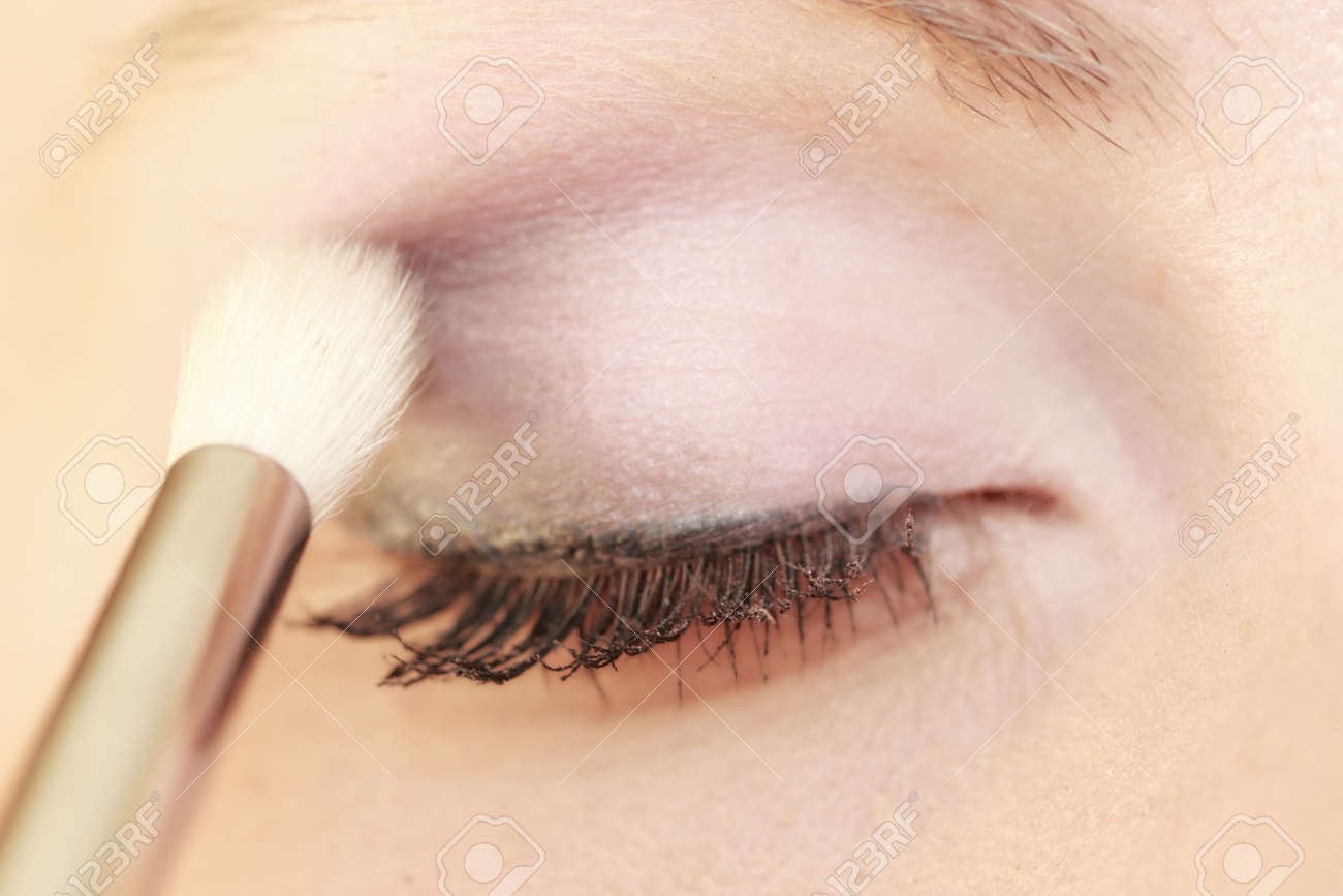 Closeup Part Of Face Female Eye Woman Applying Makeup On Eyes With