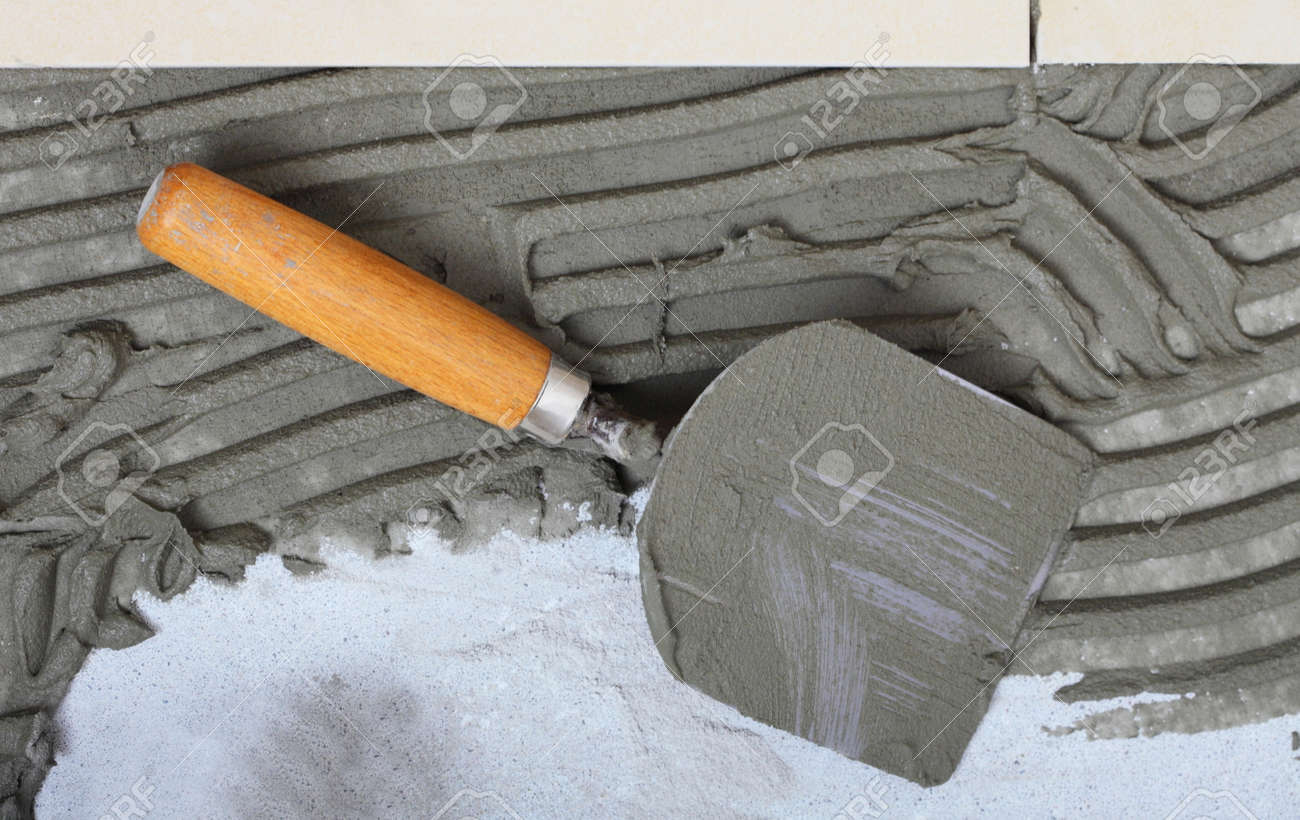 Home improvement renovation construction trowel with cement home improvement renovation construction trowel with cement mortar for tiles work tile floor adhesive dailygadgetfo Gallery