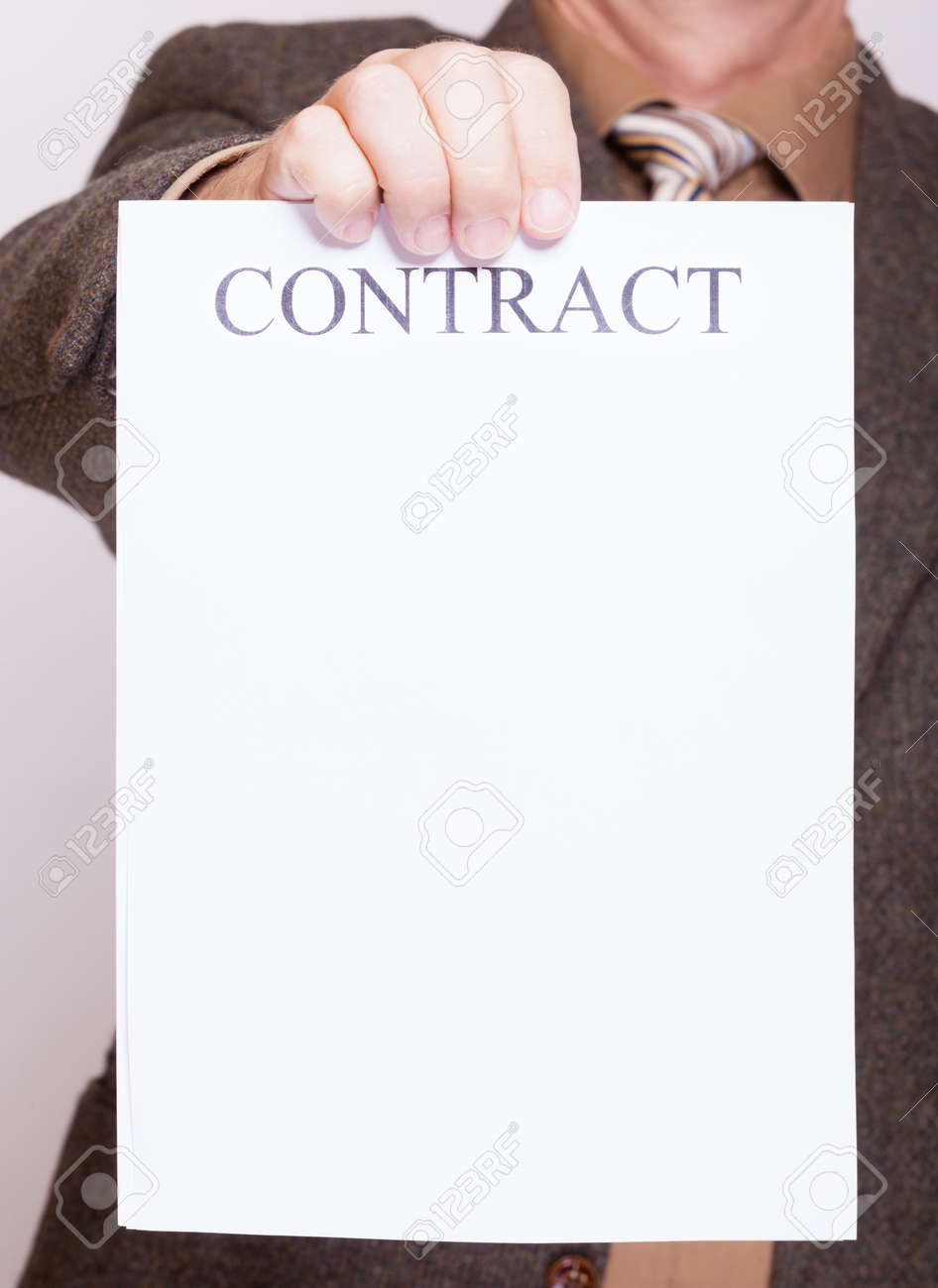 Business Concept Signing Contract. Businessman Holding Blank.. Stock ...