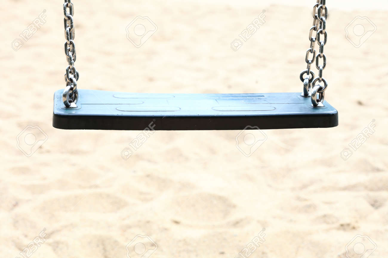Empty Swing Set Seesaw On Playground Stock Photo Picture And