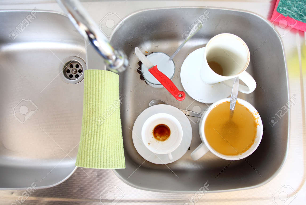 Washing Up. White Dirty Dishes In The Kitchen Sink. Stock Photo ...