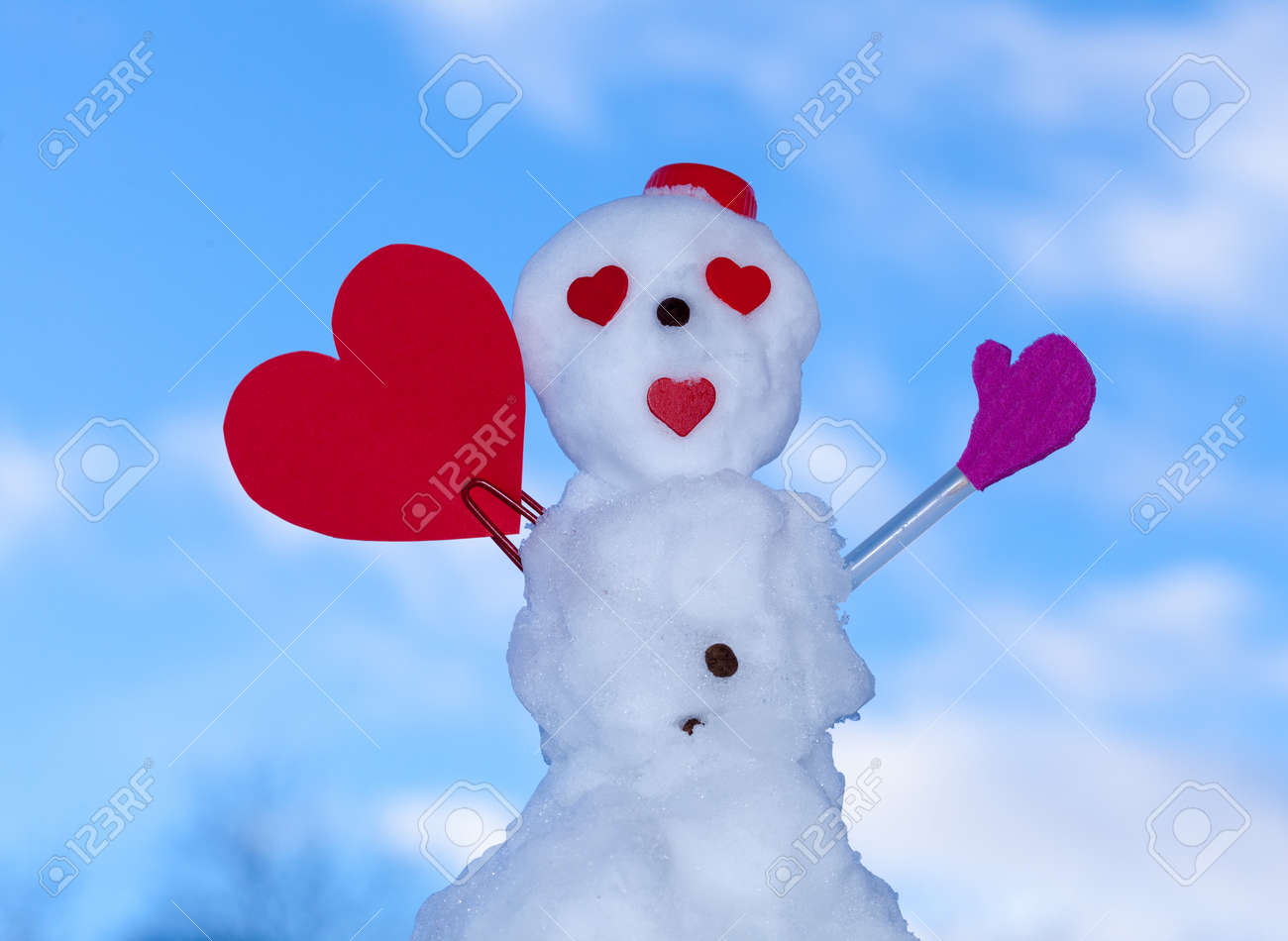 little happy valentine snowman in red scarf and with clip heart paper card text message outdoor