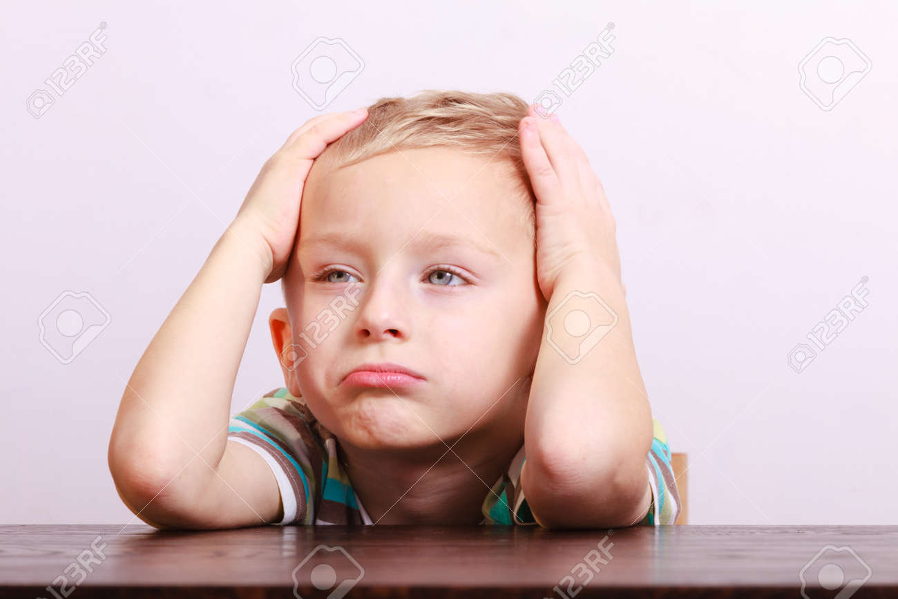 820e75e7c Portrait Of Sad Unhappy Tired Blond Boy. Child Kid Making Silly ...
