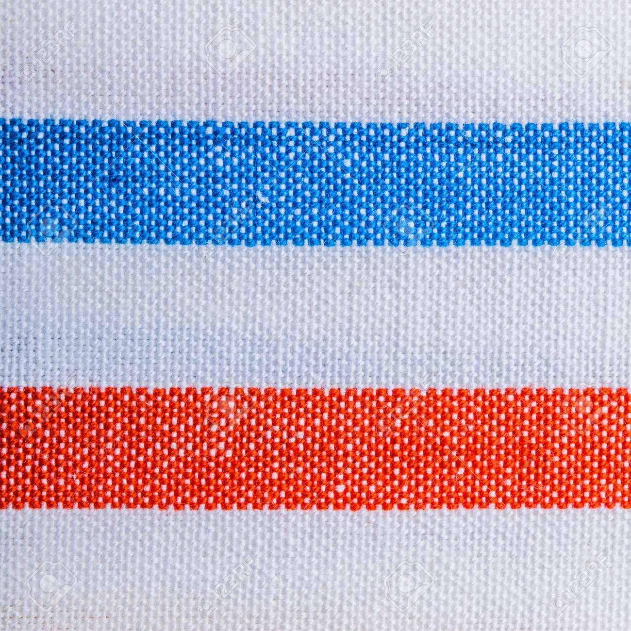 Closeup Of Colorful Red Blue White Striped Fabric Textile As Stock