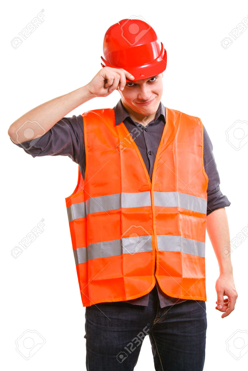 Young Man Construction Worker Builder Foreman In Orange Safety Vest And Red Hard Hat Isolated On