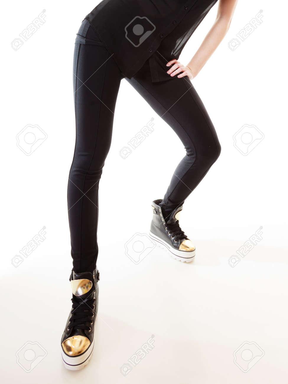 Teen fashion. Female legs teenage girl in stylish sneakers