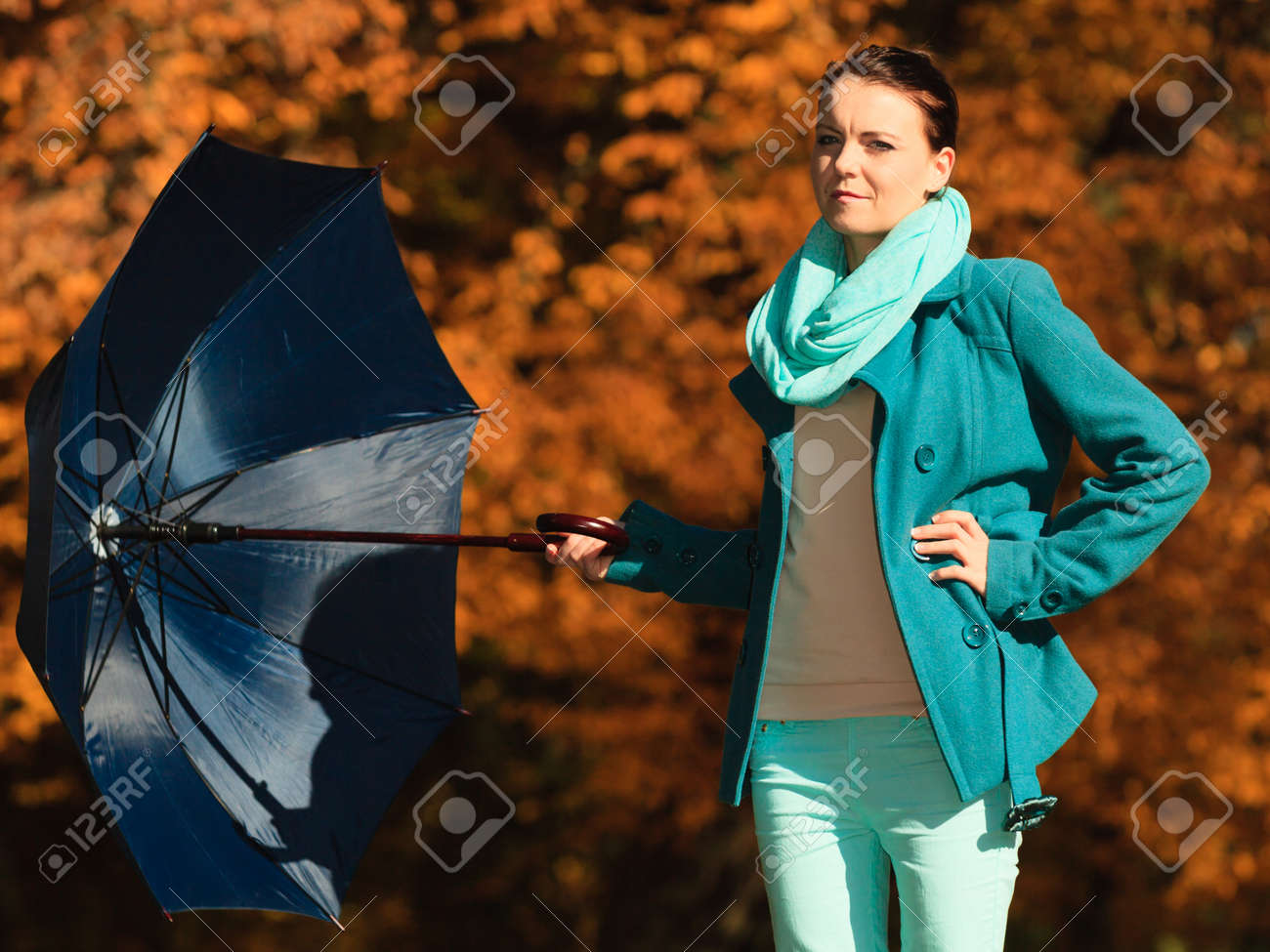 4badc3af70d Happiness freedom and people concept. Casual young woman teen girl walking  relaxing with blue umbrella