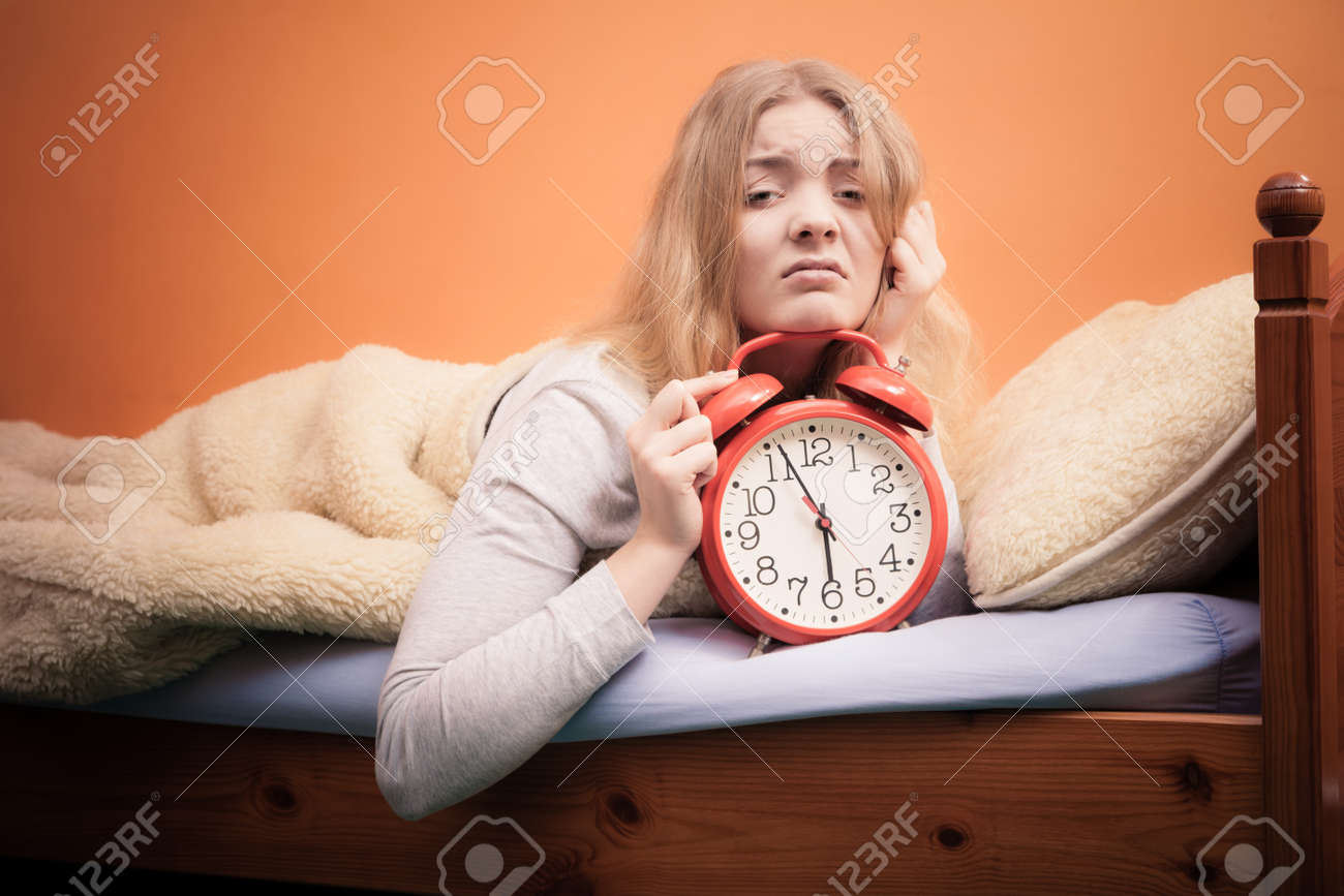 Not want to wake up concept  Funny young woman in bed waking