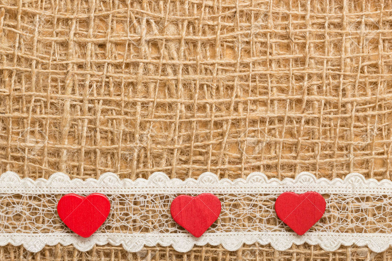 Red Decorative Hearts Lace Ribbon On Rustic Linen Cloth Background With Copy Space Stock Photo