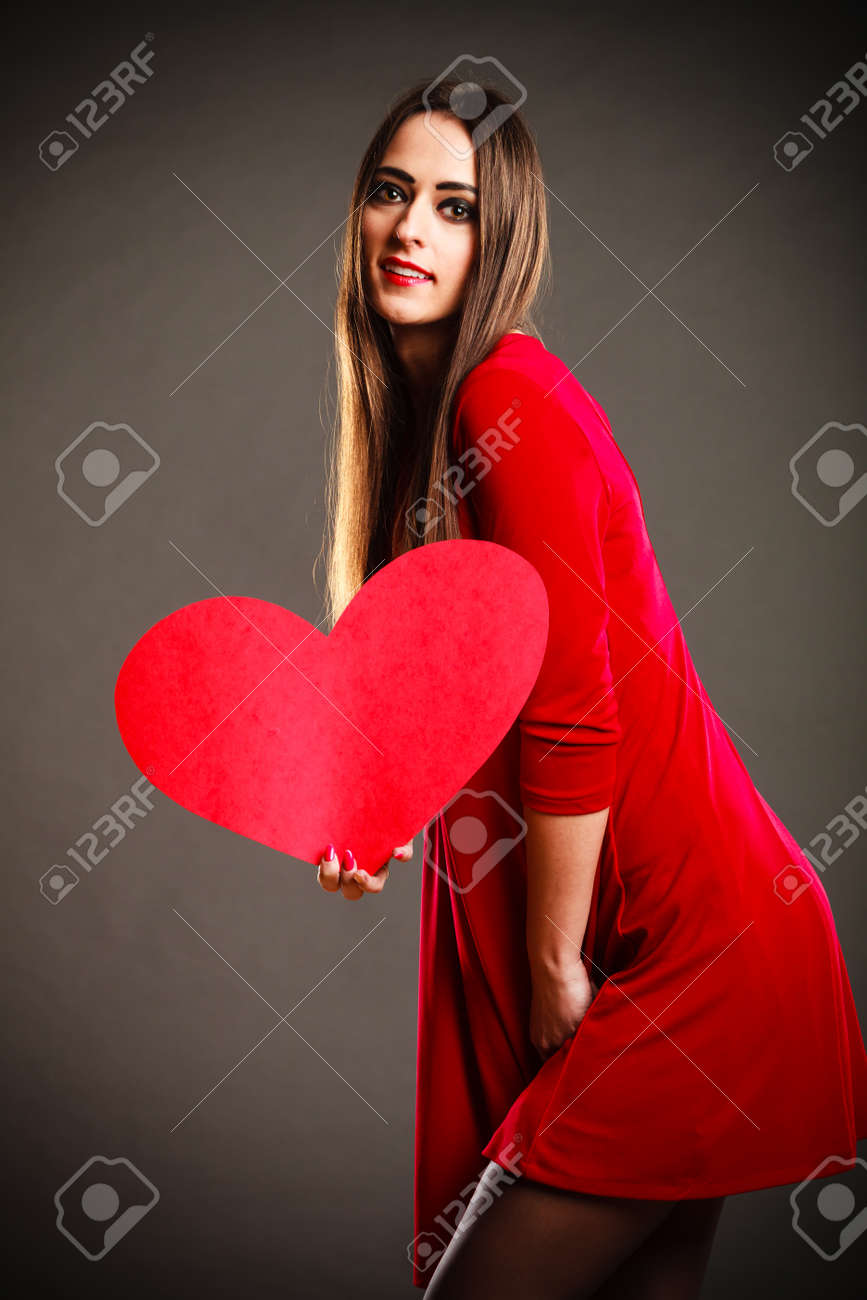 Valentines Day Woman In Red Dress Holding Heart Sign Love Symbol