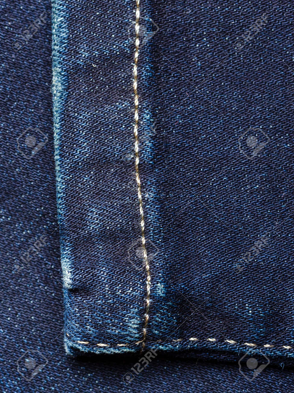 04f7cc1cb8e5 Closeup detail of blue denim jeans trouses texture background stock photo  jpg 975x1300 Detail blue texture