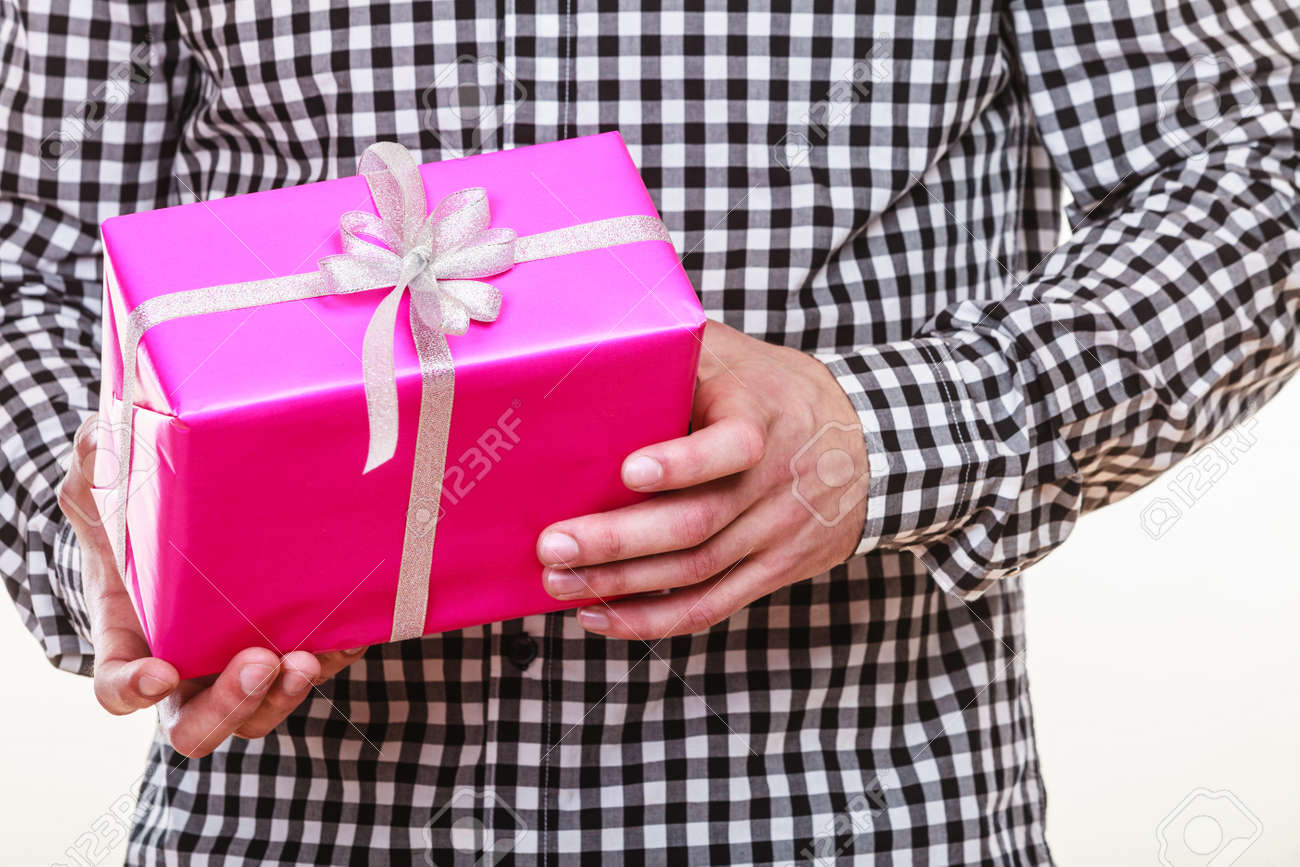 Closeup Of Man Hands Holding Pink Gift Box With White Ribbon ...