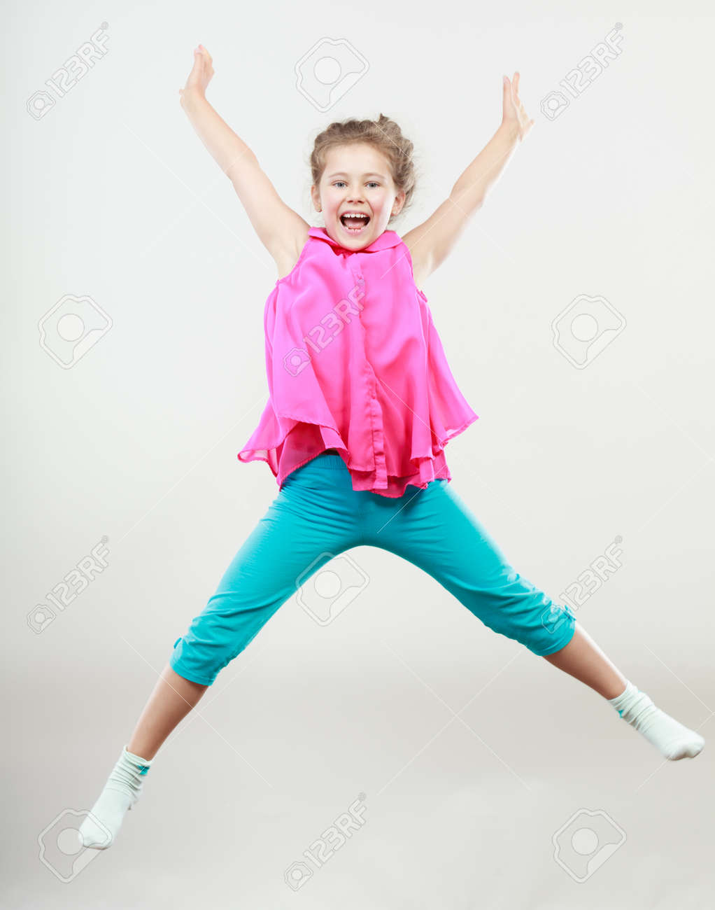 excited happy little girl jumping for joy in air joyful cheerful
