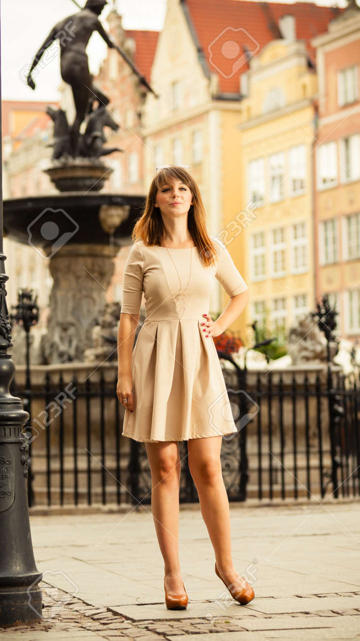 holidays and tourism concept full length pretty woman in elegant