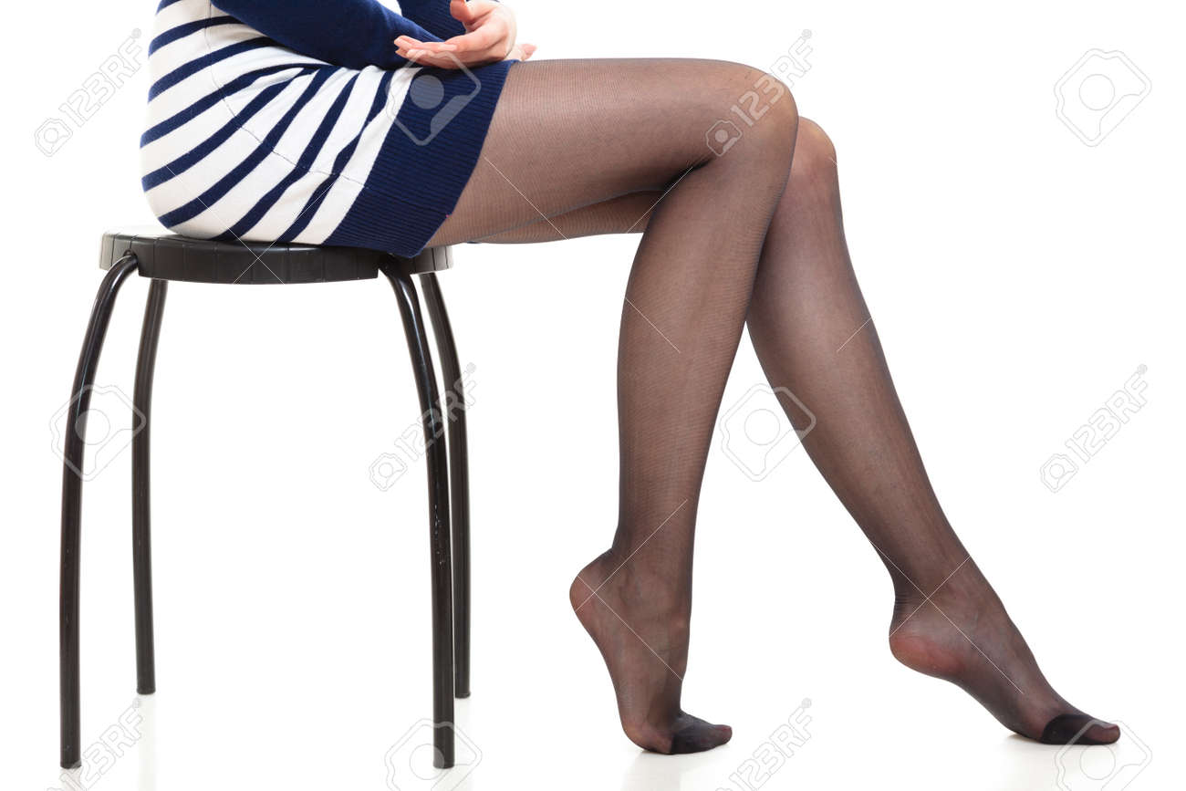 da2bbb628f30d Beauty woman legs in black tights. Part body of slim attractive girl  wearing striped dress