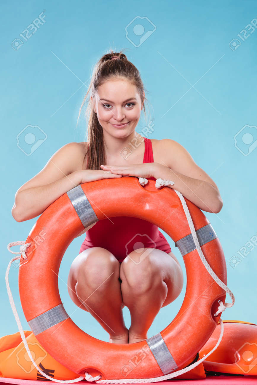 8034566df58c Happy lifeguard with ring buoy lifebuoy. Woman girl supervising swimming  pool water on blue.