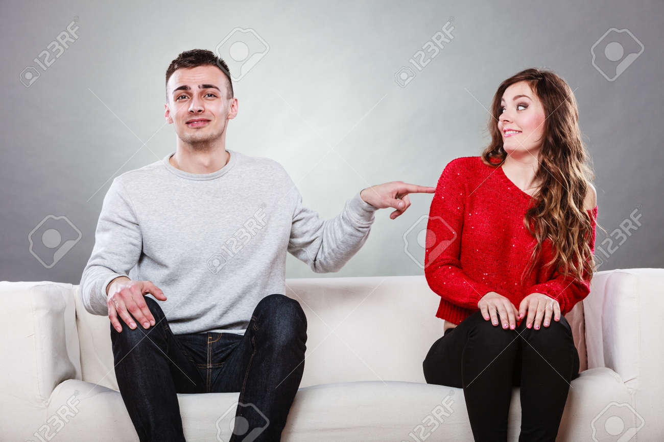 Shy Woman And Man Sitting On Sofa Couch Next Each Other. First ...
