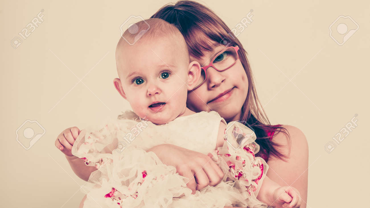Sisterly Love Two Lovely Cute Little Girls Happy Positive Childhood Stock Photo Picture And Royalty Free Image Image 56654814