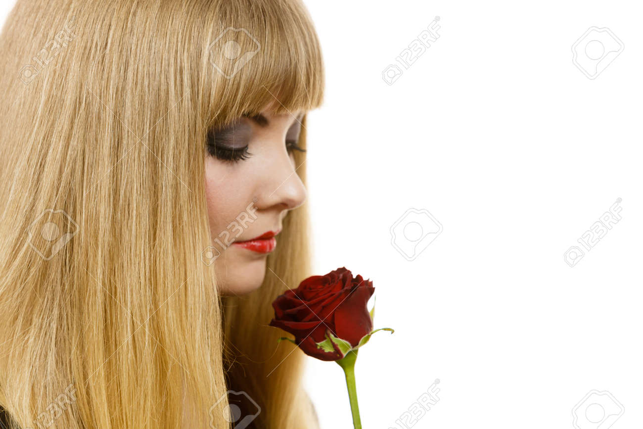 Woman holding rose flower attractive blonde lady dark makeup stock photo woman holding rose flower attractive blonde lady dark makeup studio shot isolated on white beauty holidays celebration concept izmirmasajfo Image collections