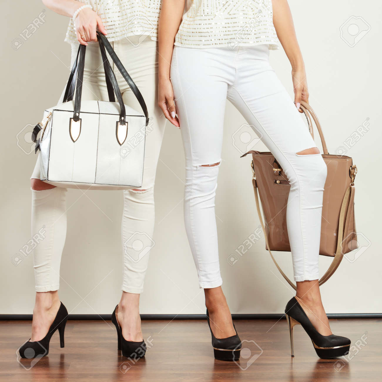 ce493cdf877 Fashion accessories for women. Two ladies holding handbags. Girls..