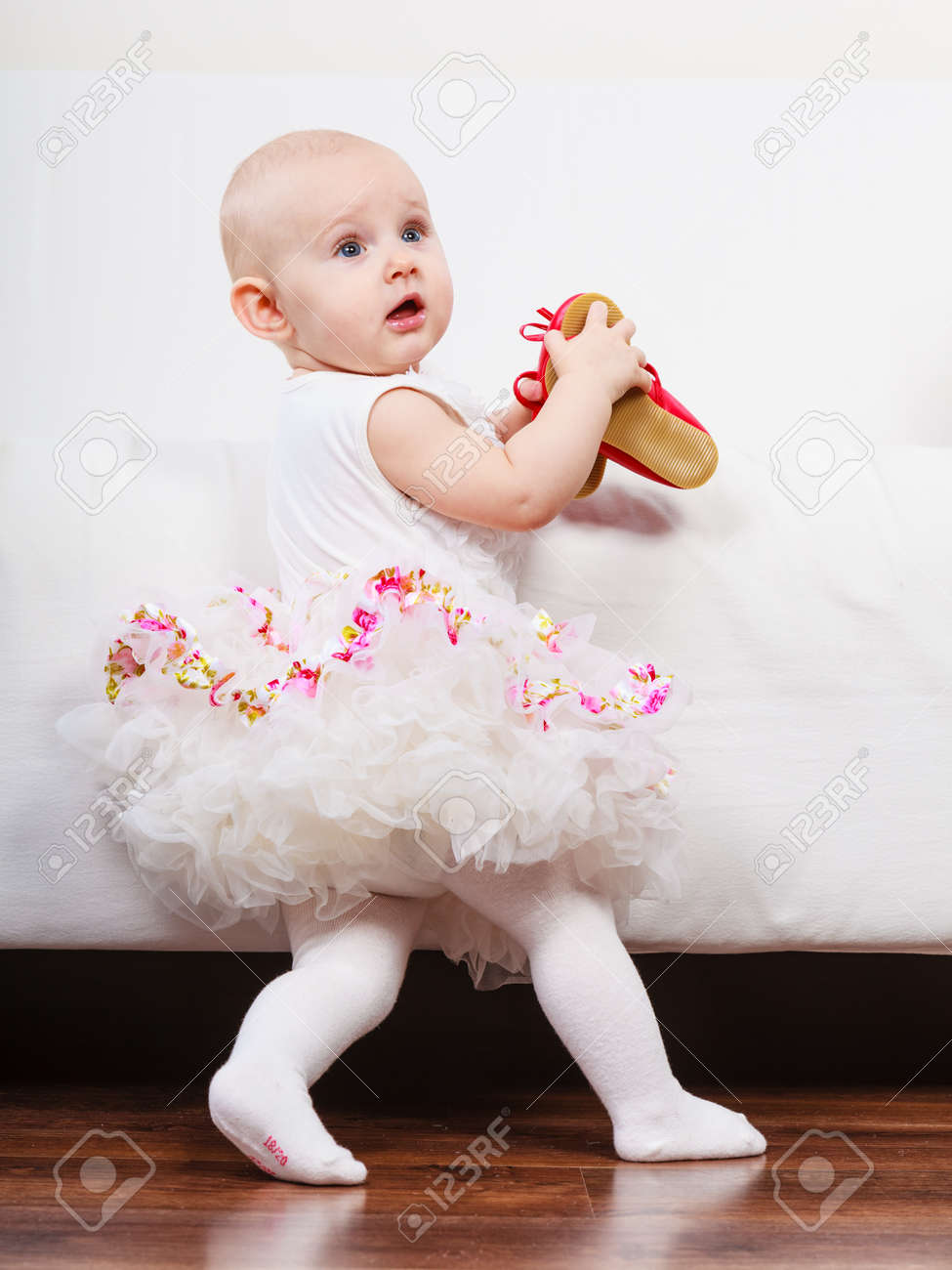 lesson of walking sweet adorable baby girl making steps at home
