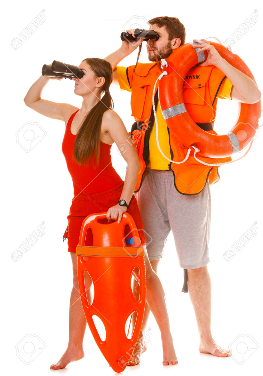 67a16134f7c Lifeguards with rescue tube ring buoy lifebuoy and life vest jacket looking  through binoculars. Man
