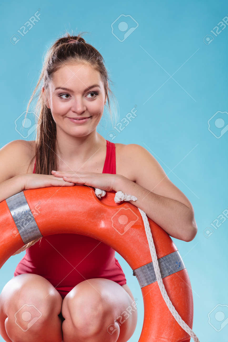 782aa4241877 Lifeguard with ring buoy lifebuoy. Woman girl supervising swimming pool  water on blue. Accident