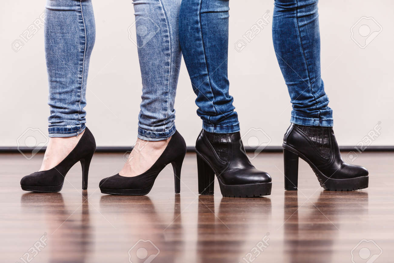 Fashion Outfit. Female Legs In Denim