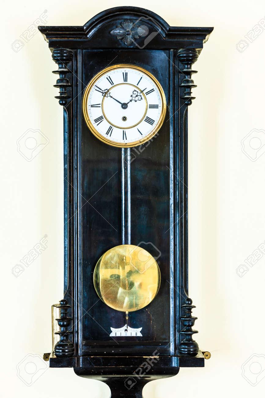 Old big wooden pendulum clock hanging on wall stock photo picture old big wooden pendulum clock hanging on wall stock photo 66033673 amipublicfo Image collections