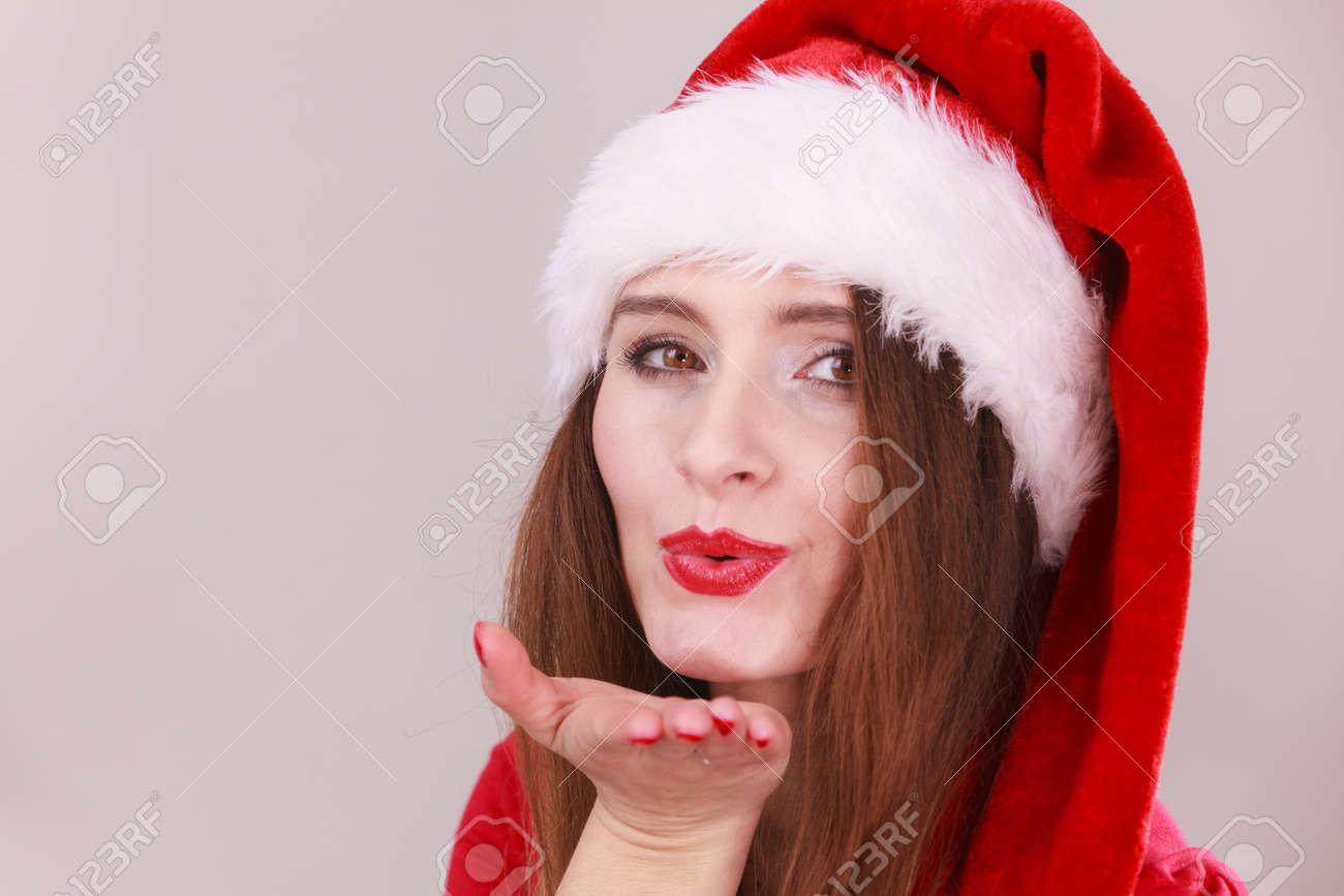 Weihnachten Mädchen Weht Ein Kuss. Junge Dame Mit Weihnachtsmann ...