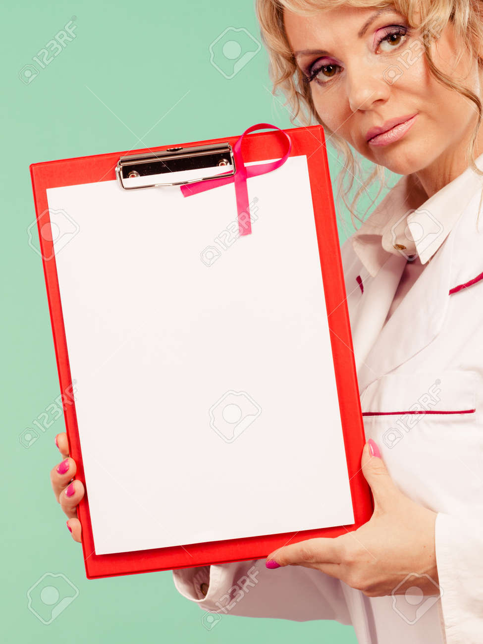breast cancer tumor. mature woman doctor showing red folder with