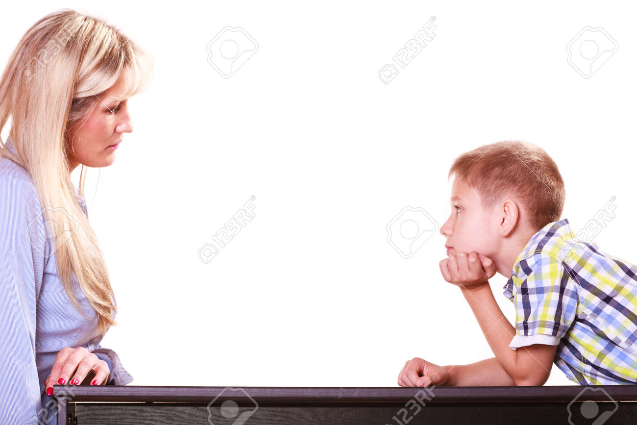 Relationships arguments and discussion. Mother and son sit at table and argue discuss solve problem. - 126572895
