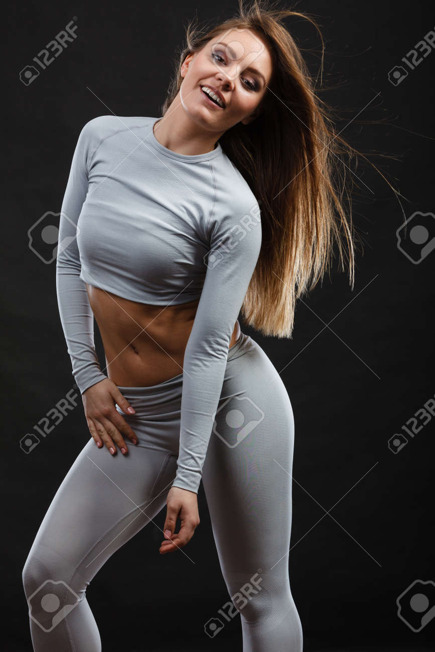 e8f018f49da37 Beauty seducive shape fit body concept. Attractive girl posing. Youthful  smiling lady presenting thermoactive