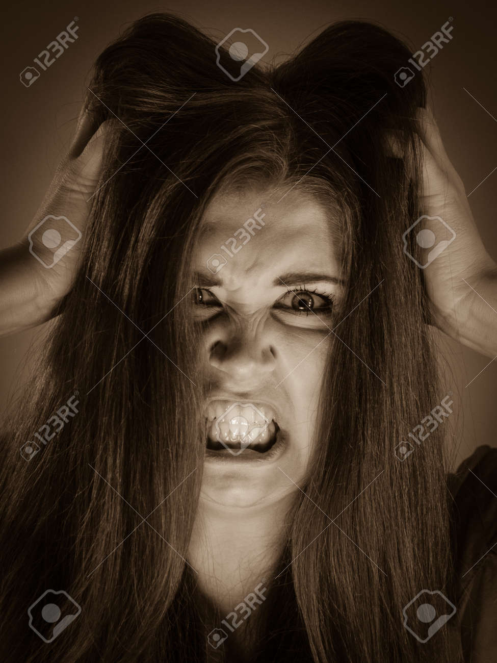 Angry pretty attractive woman being pissed off. Very frustrated lady having  brown hair. Stock