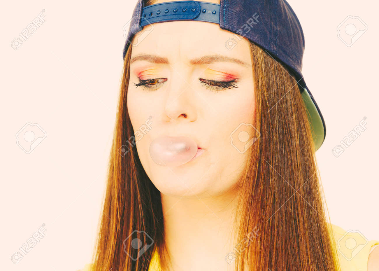 Woman casual style teen girl cap on head colorful makeup doing