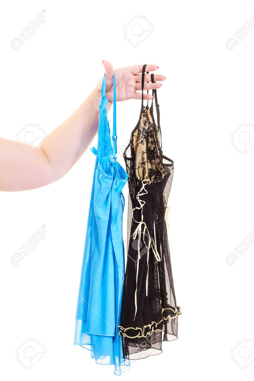 0905fcdc5b Stock Photo - Woman hand wearing satin lingerie picking nightwear sleepwear