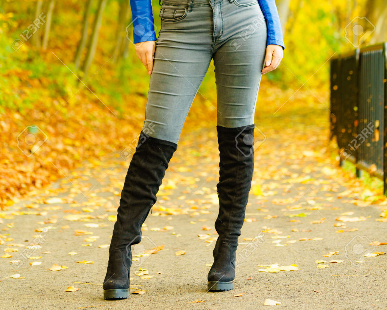 Woman Wearing Long Black Heeled Knee
