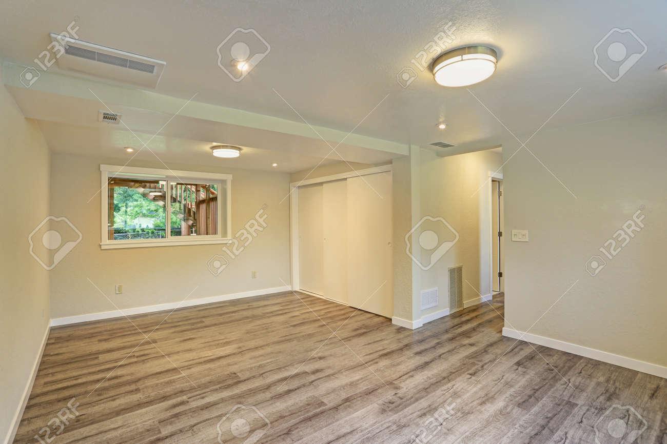 American house interior design bright beige large empty room with hardwood floor built in closet small window
