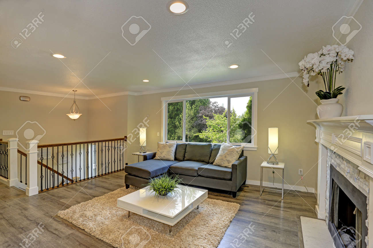 . Second floor landing living space with a white fireplace accented