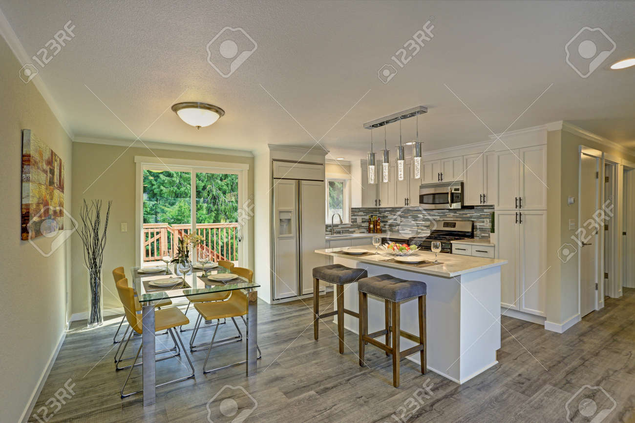 Beautiful Open Plan Second Floor White Kitchen With Dining Space Traditional Style Cabinetry
