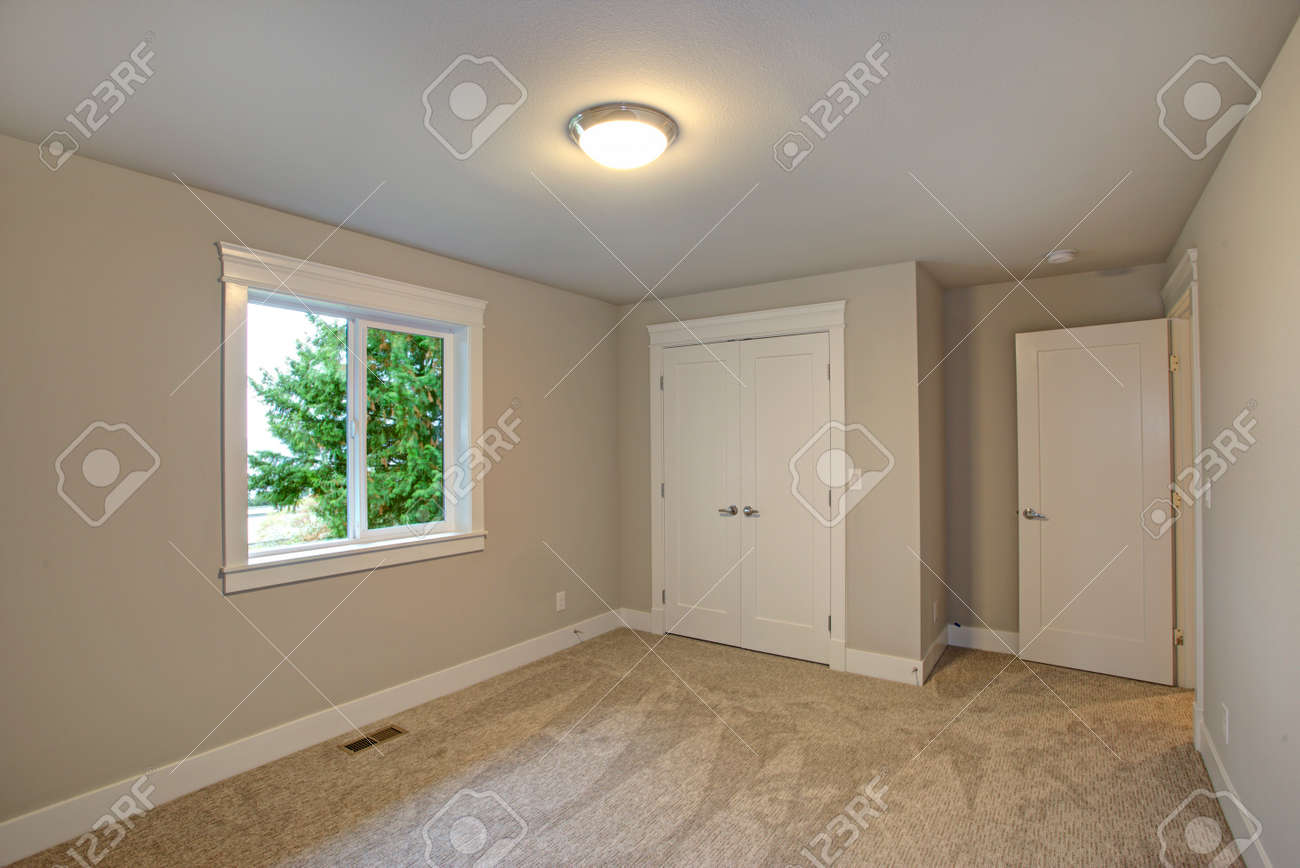 New Construction Home Interior Features Empty Room With Beige